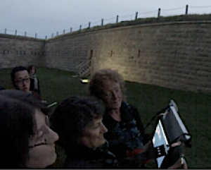 A group playing Operation:Citadel around the walled ditch surrounding the Halifax Citadel National Historic Site